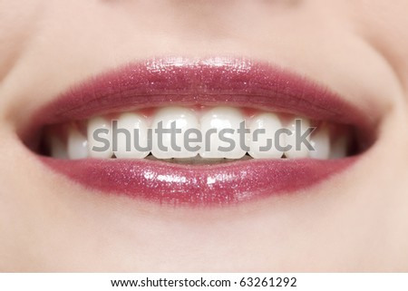 Sexy woman lips with pink makeup and gloss