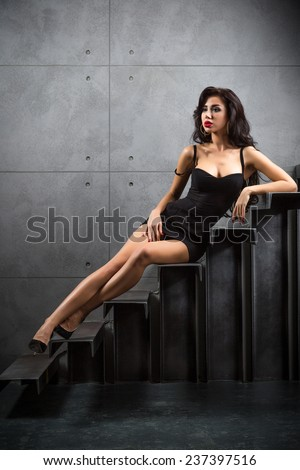 sexy woman lying on stairs at backyard of building
