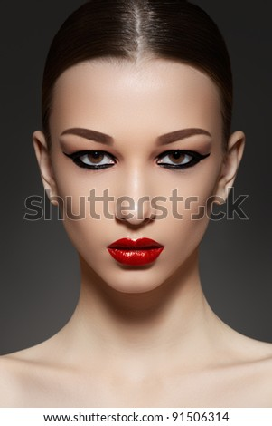 Sexy woman model with face bright red lips makeup, strong eyebrows & cheekbones, fashion eyeliner make-up and healthy clean skin. Evening glamour style - stock photo