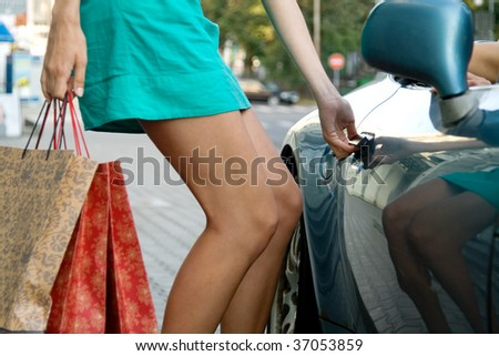 sexy woman near car after shopping - stock photo