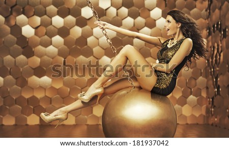 Sexy woman on a big ball - stock photo