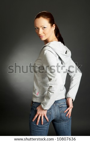 sexy woman on a dark background - stock photo