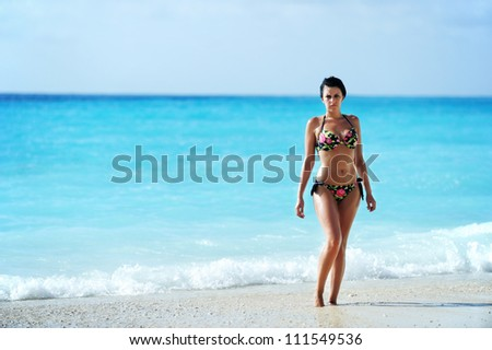 Sexy woman on an exotic beach