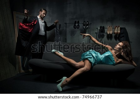 Sexy woman on the coach - stock photo