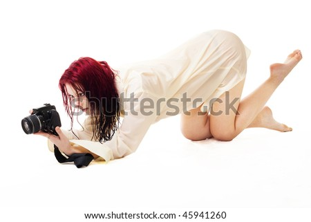 Sexy woman photographer in wet clothes isolated on white - stock photo