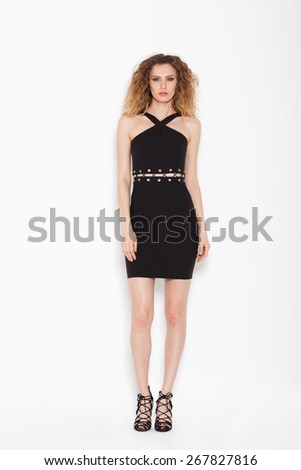 sexy woman posing in black dress on white background