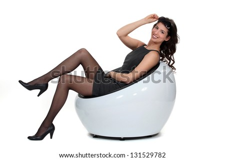 Sexy woman relaxing on chair - stock photo