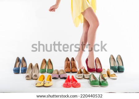 Sexy woman's legs with shoes collections on white background - stock photo