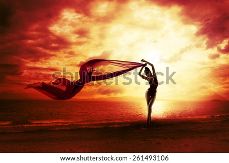 Sexy Woman Silhouette over Red Sunset Sky, Sensual Female on Beach, Vacation Holiday Concept, Girl with Windy Flying Cloth - stock photo