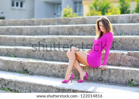 Sexy woman sitting on a stairs