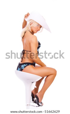 Sexy woman sitting on chair and posing