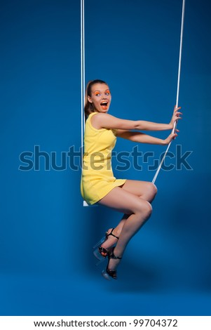 Sexy woman smile on swing with uv make-up - stock photo