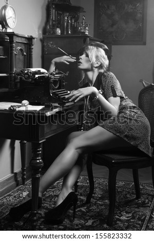 Sexy woman smoking a cigarette  - stock photo