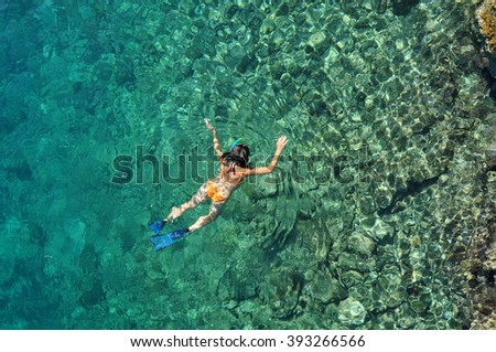 Sexy woman snorkeling - stock photo