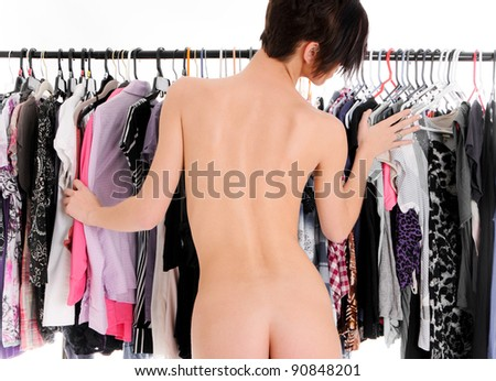 Sexy Woman trying to decide on what to wear - stock photo