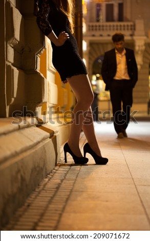 Sexy woman waiting for man on the street - stock photo
