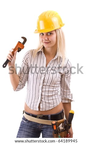 Sexy woman with adjustable wrench in hand looking at camera. Isolated on white background