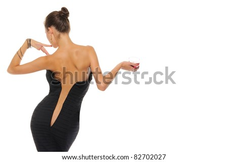 sexy woman with an unbuttoned dress and glass of wine isolated on white - stock photo