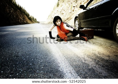 Sexy woman with baggage near to car - stock photo