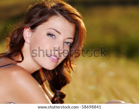 Sexy woman with beautiful fresh face  posing outdoors - stock photo
