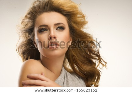 Sexy woman with big hair - stock photo