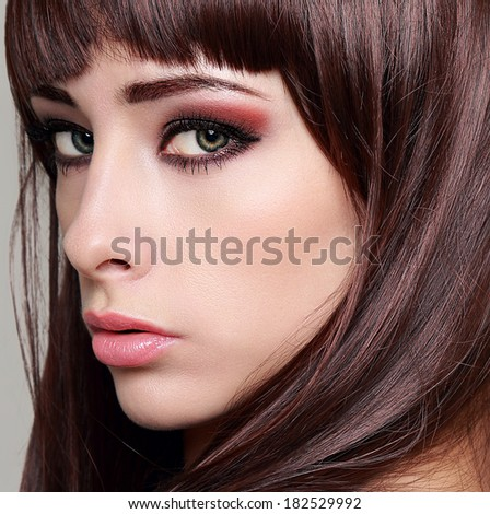 Sexy woman with bright makeup eyes and long lashes. Closeup - stock photo