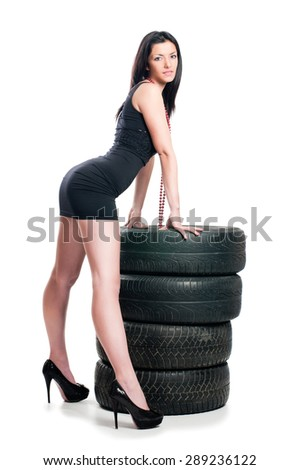 Sexy woman with car tire