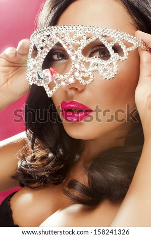 Sexy woman with crown like glasses - stock photo