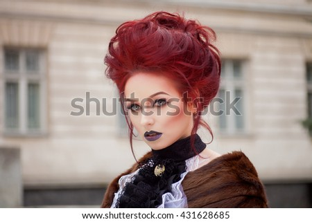 Sexy Woman With Gothic Makeup And Red Hair Against Old Castle
