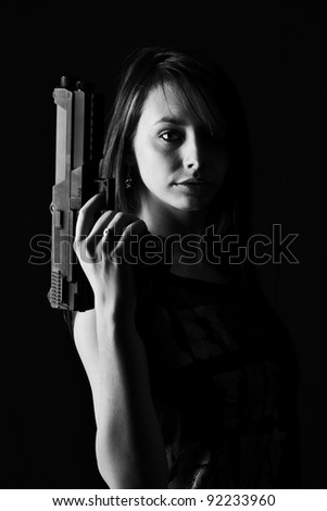 Sexy woman with Gun, isolated on black background