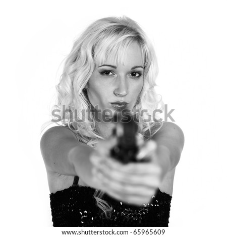 Sexy woman with handgun in studio
