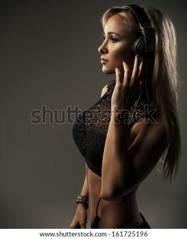 Sexy woman with headphones  - stock photo