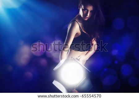 Sexy woman with  lamp - stock photo
