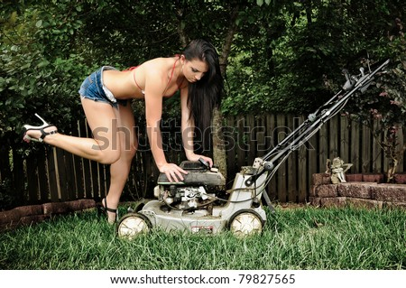 Sexy Woman with Lawn Mower - stock photo