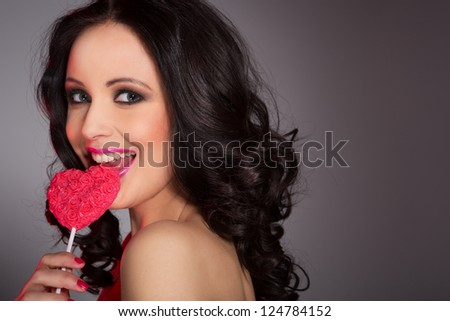 Sexy woman with lollipop - stock photo
