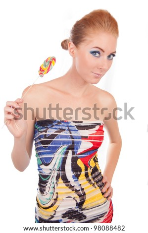 Sexy woman with lollipop over white - stock photo