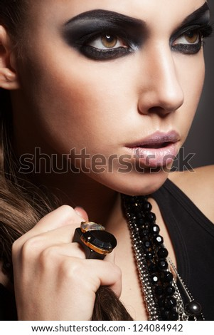 Sexy woman with long hair, make-up and smokey eyes - stock photo