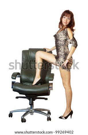 Sexy woman with luxury office armchair, isolated over white background - stock photo