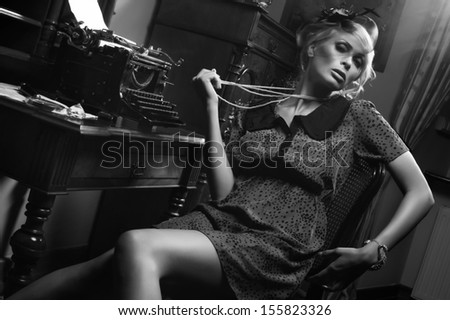 Sexy woman with pearls in room - stock photo