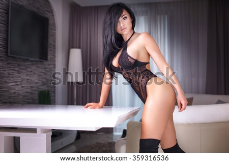Sexy woman with perfect body posing in sensual lingerie in hotel room. - stock photo
