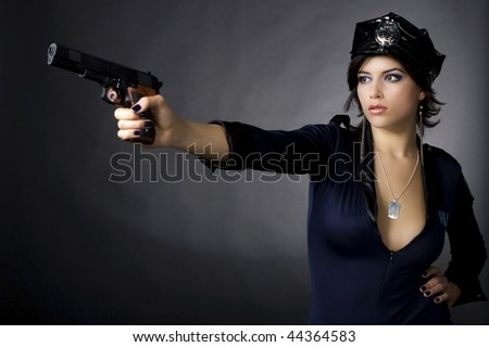 Sexy woman with police uniform in studio  on dark gradient background - stock photo