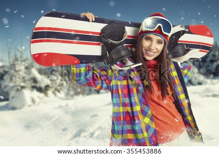 sexy woman with snowboard outdoors - stock photo