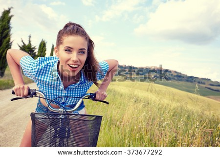 Sexy woman with vintage bike in a country road. - stock photo