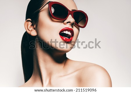 sexy woman with white teeth in sunglasses