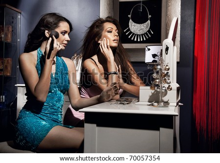 Sexy women doing make up - stock photo
