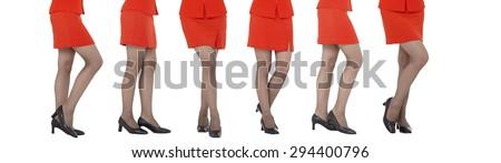 Sexy women legs isolated white backgroundn legs, red skirt - stock photo