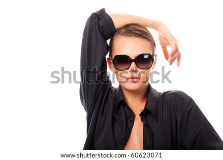 sexy young adult in sunglasses and black shirt isolated on white in studio - stock photo