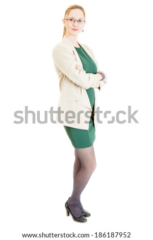 sexy young blonde girl wearing a green dress, jacket, black panti-tights and sandals - stock photo