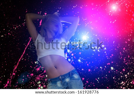 Sexy young blonde lady in night club - stock photo