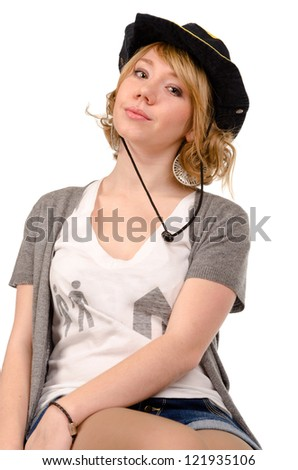 Sexy young blonde woman sitting on a stool in a cowboy hat with her head tilted to one side isolated on white - stock photo